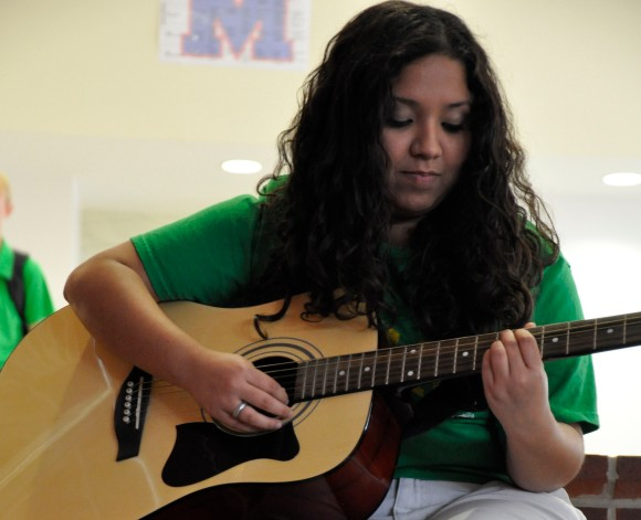 Photo by Brighton Nivers Strumming Away Castaneda sharing one of her songs with the newspaper staff.